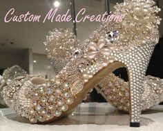 'Lee' is a unique design of crystals, pearls & embellishments.    If your wanting show stopping look no further.    'Lee'  is pictured in a 4 inch heel pump style shoe.    Crystal colours shown are 32, with ivory pearls & gold peacock .      Want your very own custom pair created just for you?  Contact us with your special requirements & we will do our best to accommodate your needs.     OUR SHOES ARE COMPLETELY CUSTOMISABLE      Choose: HEEL HEIGHT,CRYSTAL COLOURS,PEARL COLOURS,SHOE STYLE.