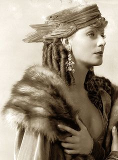 Greta Garbo, Romance — 1930 - velvet hat with crow's wings. It looks like the chapeau of a Greek Goddess!