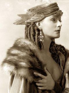 Greta Garbo, Romance — 1930 - velvet hat with crow's wings. It looks like the chapeau of a Greek Goddess!