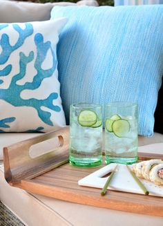 green glassware, pillows + wood serving tray from @hayneedle