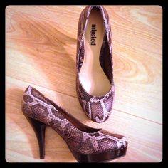 """New snakeskin pumps Never worn, 4"""" heel with 1"""" platform Shoes Heels"""