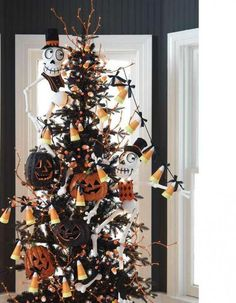 Great idea for the old plastic tree. Halloween next year!