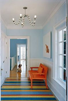Many people love a white or neutral room but still want to add a splash of color. A painted floor is not only another way to add color and texture to your space, but it can serve to pull all your pieces together. Hadley Court Interior Design blog