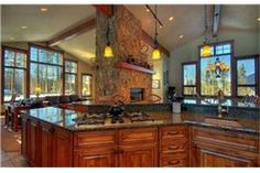 High ceilings and lots of windows keep this kitchen from feeling dark.