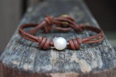 Pearl Bracelet with Wrapped / Knotted Distressed Brown Leather and Vintage Button - White Round Pearl, Minimalist, Stackable, Rustic, Boho. $29.00, via Etsy.