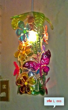 Light from plastic bottles A lamp recycling, Lamp from plastic,Light .I love this Lampshade made/ build up from (glass painted) plastic (PET) bottles cut shapes.Replace broken glass shade with colored plastic piecesButterflies made from milk jugs and Reuse Plastic Bottles, Plastic Bottle Flowers, Plastic Bottle Crafts, Recycled Bottles, Recycled Crafts, Diy And Crafts, Puzzle Lampe, Craft Projects, Craft Ideas