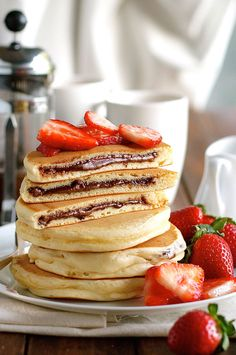Not that I'd eat this but looks yummy just substitute the nutella with chocolate and I'd be set! Nutella Stuffed Pancakes - frozen Nutella discs makes it a breeze to make the Nutella stuffed pancakes! Brunch Recipes, Breakfast Recipes, Dessert Recipes, Pancake Recipes, Pancake Ideas, Pancake Toppings, Snack Recipes, Dessert Food, Breakfast Ideas