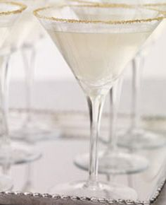 """""""Fire and Ice"""" martini: 2 oz. ginger and jalepeno-infused vodka 2 oz. grapefruit syrup 1 oz. fresh-squeezed white grapefruit juice Shake with ice in a martini shaker, strain, and serve in a gold suger-rimmed martini glass."""