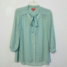 "*15% off Bundles* ELLE Sheer Mint Blouse Sheer mint blouse with gold embroidery. 26"" shoulder to hem. 20"" armpit to armpit. 99% Polyester 1% metallic. Elle Tops Blouses"