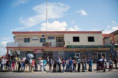 A weekend of looting and clashes left at least three people dead in Venezuela, authorities said, as anger roiled over a chaotic currency reform that left many without cash.  A man, a woman and an adolescent boy were shot dead when violence erupted on Saturday in the town of La Paragua, in the southern
