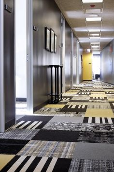 FLOR / Multiple Styles & Colors / Zagnoli McEvoy Foley LLC / Chicago, IL / You can never go wrong with a black and yellow color scheme. Play with different patterns and colors to give your space a look like no other.