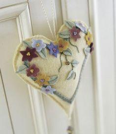 http://www.allpeoplequilt.com/bags-pillows-gifts/pincushions/wool-heart-valentine