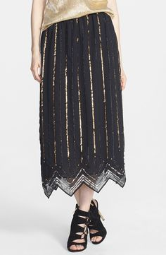 On trend | Sparkly gold sequin maxi skirt