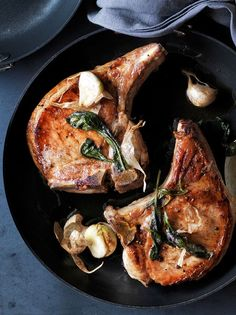 Garlic and Thyme Brined Pork Chops | Lean pork chops benefit from brining, or being soaked in a flavorful saltwater solution, to ensure juicy results.