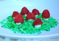 "Fairy Party Raspberry Toadstools-raspberries w/ mini marshmallows on top of a bed of green dyed coconut ""grass"""
