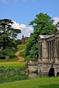On the grounds of Stowe House, Stowe, Vale of Aylesbury, Buckinghamshire, England, Great Britain, United Kingdom. To the right is the Palladian Bridge, a copy of the bridge at Wilton House, which was completed in 1738. It originally crossed a stream that emptied from the Octagon Lake, and when the lake was enlarged and deepened, made more natural in shape in 1752, this part of the stream became a branch of the lake.