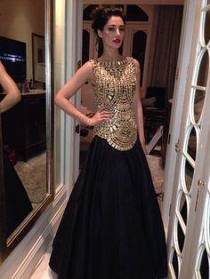 Abu Jani Sandeep Khosla. The black taffeta gown features an intricate gold bodice in mirror work and zardozi.