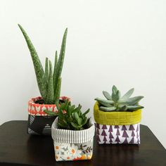 "Make these adorable, colorful, double sided fabric ""sleeves"" to cover plastic pots succulents"