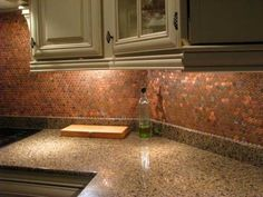 A coppery backsplash made entirely from pennies.