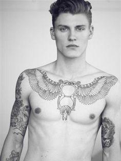 Mikkel Jensen, I don't really like tattooed men, but..