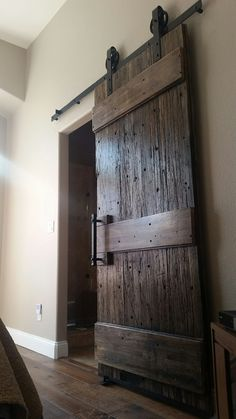 Custom barn door with reclaimed wood from an old semi truck designed and built by BRE, LLC