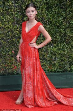 Making a splash: Actress and singer G. Hannelius brightened up the room in a regal red gown