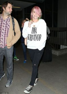 Kesha's rainbow colored hair is fun, but we're seriously loving her IMA SURVIVOR sweatshirt. #Music #Fashion