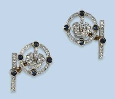 A PAIR OF RUSSIAN SAPPHIRE AND DIAMOND CUFF LINKS   Each designed as a diamond-set crown within a similarly-set loop with sapphires at the cardinal points, to a sapphire and diamond-set baton link, modern Russian marks