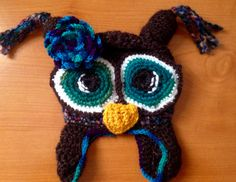 Owl hat with flower detail made to order @ A Stitch A Head Custom Designs find me on etsy and Facebook
