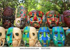 Colorful Mayan handcraft masks of indian culture in Jungle of Mexico - stock photo
