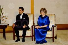 Prince Charles wears a black tuxedo and Princess Diana wears an elegant blue gown with a matching headband during a visit to Japan. Stylist Yuki Sharoni prepared Princess Diana for the evening out. May 12, 1986 Japan