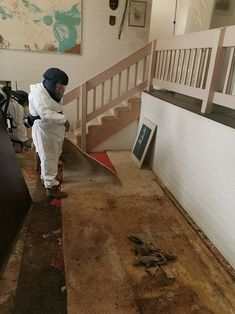 Mould Technician removing carpets for property restoration and removing mould