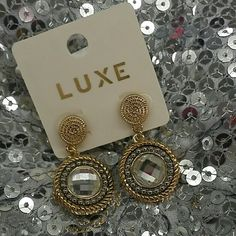 Luxe brand dangle earrings gold silver rhinestone Hi! Simple yet classy. Little gold little silver and a faux rhinestone in the middle.  Post back. New luxe Jewelry Earrings