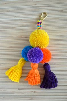 Pom pom keychain Pom pom bag charm Tassel keychain Purse Charm Boho keychain Handbag charm Tassel clip Pompom key chain Neon pink Mint Colorful bag charm / key chain made of hand crafted pom poms and tassels. Available in 4 colors: hot pink, purple, mint Tassel Keychain, Diy Keychain, Pom Pom Crafts, Yarn Crafts, Homemade Crafts, Diy And Crafts, Pom Pom Bag Charm, Pom Pom Wreath, Diy Craft Projects