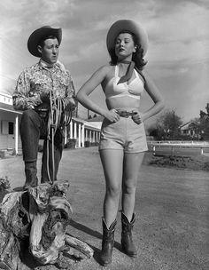 In 1949, actors Wayne Burson and Wendy Waldron pose on set. | 15 Retro Pics Of Truly Badass Cowgirls