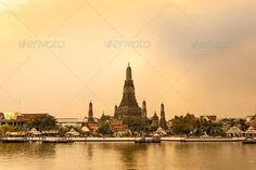Wat Arun Thailand Temple in Sunset scene ...  Chao Phraya River, Famous Place, Southeast Asia, architecture, arun, asia, bangkok, bangkok province, boat, buddhism, cityscape, destinations, dusk, khmer, landmark, local landmark, national landmark, night, pagoda, phraya, place, religion, river, skyline, stock images, stupa, sunset, temple, thailand, tourism, travel, travel destinations, twilight, vacations, wat, wat arun, water