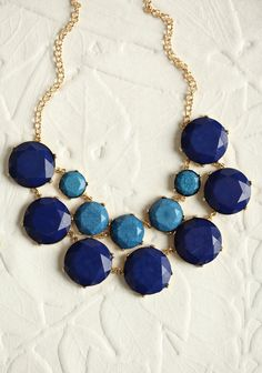 Sapphire Glow Stone Necklace  22.99 at shopruche.com. Featuring deep sapphire blue and smaller midnight blue faceted stones, this gorgeous gold-toned necklace is a stunning statement piece that can be worn year round.22