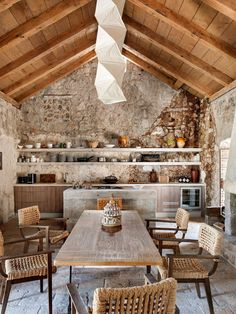 Stone house of the 15th century with sea views in Dubrovnik #interior #design #home #decor #idea #inspiration #style #room #cozy #light #color #dining #rustic #table #chairs #stones #wooden #beams #shelves #open