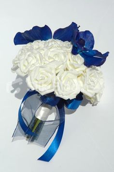 Beautiful Ivory Rose Bridesmaid Bouquet w/ Midnight Blue Orchids Beautiful Ivory Rose Bridesmaid Bouquet w/ Midnight Blue Orchids [Miranda - Bridesmaid] - £49.99 : Artificial Wedding Flowers | Bridal Bouquets | Silk Wedding Flowers | Wedding Bouquets | Wedding Flowers, Silk Blooms Glasgow, we sell and hire artificial wedding flowers, bridal bouquets, buttonholes and wedding table arrangements.
