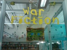 Teen Book Display - War Fiction (I used a bucket of Toy Story soldiers to help decorate this display.)