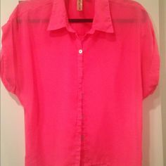 Hot pink hi lo blouse Originally bought at Macy's. Needs a tank top under it. Great for the summer since its light and has a great color. Buttons all the way down. Cuffs on the Short sleeves. Some minor nicks on front of shirt, not noticeable. Collar on top. The front of the blouse is shorter than the back. Machine wash and air dry. 100% polyester. Tops Blouses
