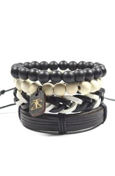 Product Details - 4 Piece Set - Includes 2 pull-closure bracelets made from leather and two 10mm beaded wood bracelet Color: Black/White Material: Leather, Cord