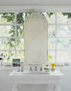 love the vintage mirror on the window