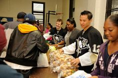 Penguins players delivered turkeys and other food items to Hill District families