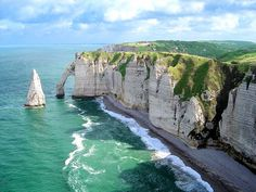"Étretat, France is best known for its cliffs, including three natural arches and the pointed ""needle"". These cliffs and the associated resort beach attracted artists including Eugène Boudin, Gustave Courbet and Claude Monet, and were featured prominently in the 1909 Arsène Lupin novel The Hollow Needle by Maurice Leblanc."