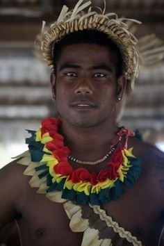Picture of Traditional Kiribati dance performed by an intense looking Kiribati guy