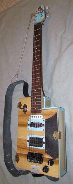 unique cutaway cigar box guitar with a Higgins bender