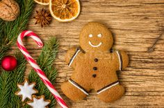 A gingerbread man on a wooden background with christmas decorati stock photo (c) Zerbor (#6272996) | Stockfresh