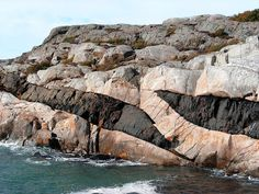 Apophyses (branches) of dark-coloured dolerite dykes in Kosterhavet National Park on Ramsö island in the Koster Islands in Sweden. The dykes intruded between the Gothian orogeny (1.64 to 1.52 Ga) and the Sveconorwegian orogeny (1,2 to 0.9 Ga) at about 1.44 Ga