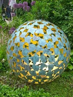 "What do you think of this sculpture by David Harber called ""The Mantle""?    A perfect sphere made up of hundreds of bronze shapes creating a latticework of blue green verdigris.     The underside of each piece is gilded with 23-carat gold leaf, designed to catch the sunlight and create a warm ethereal golden glow within the sculpture.     By night a candle can turn the piece into an enchanting lantern.    I want one. What about you?"